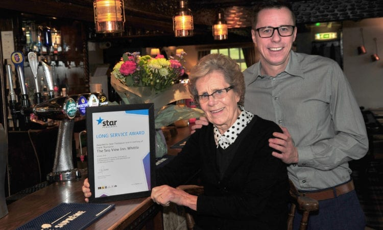 Jean Thompson, who is celebrating 40 years at the Sea View with Lee Thompson, her son